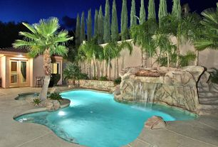 Rustic Swimming Pool with French doors, Fence, exterior stone floors