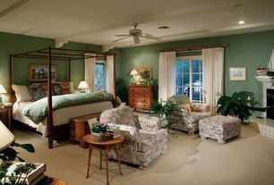 Traditional Master Bedroom with Ceiling fan, Carpet, Exposed beam, stone fireplace