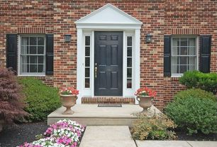 Traditional Front Door with Raised beds, exterior tile floors, Casement, exterior brick floors, exterior concrete tile floors