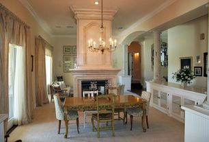 Traditional Dining Room with Columns, Crown molding, High ceiling, Chandelier, Carpet
