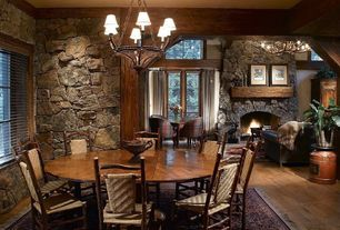 Rustic Great Room with Hardwood floors, Chandelier, stone fireplace