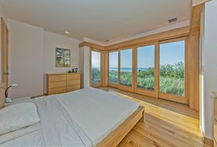 Contemporary Master Bedroom with can lights, sliding glass door, Hardwood floors, Standard height, French doors