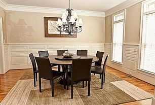 Contemporary Dining Room with Chandelier, Wainscotting, Crown molding, Hardwood floors