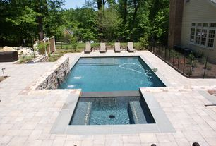 Traditional Swimming Pool with exterior stone floors, Lap pool, Raised beds, Fence, Pathway, Fountain