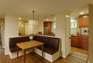 Contemporary Dining Room with Pendant light, Hardwood floors, Crown molding