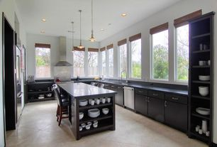 Contemporary Kitchen with Soapstone, Undermount sink, Pendant light, Crown molding, Glass panel, L-shaped, Kitchen island