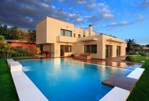 Modern Swimming Pool with Lap pool, Fountain, French doors