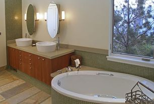 Contemporary Master Bathroom with American pride - frameless polished oval medicine cabinet, Double sink, Vessel sink, Flush