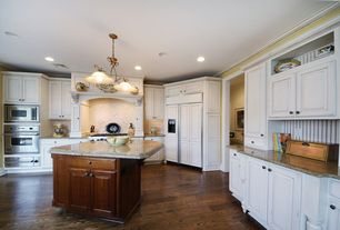 Traditional Kitchen with Custom hood, Kitchen island, Northern red oak - cocoa bean 3 in. engineered hardwood plank, L-shaped