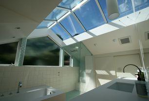 Modern Master Bathroom with Shower, Casement, flush light, drop in bathtub, Master bathroom, Wall Tiles, Skylight, can lights