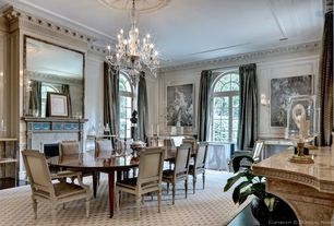 Traditional Dining Room with French doors, Chandelier, Crown molding, Hardwood floors, Arched window, Chair rail