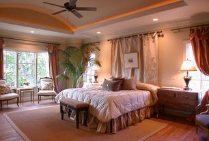 Traditional Master Bedroom with can lights, French doors, Hardwood floors, Ceiling fan, Crown molding, Casement
