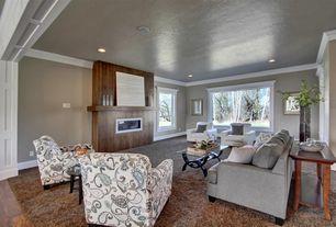 Traditional Living Room with Crown molding, Hardwood floors, Built-in bookshelf