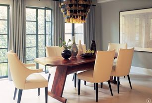 Contemporary Dining Room with French doors, Standard height, Hardwood floors, Crown molding, Chandelier