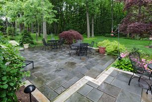 Traditional Patio with exterior stone floors