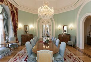 Traditional Dining Room with Arched window, French doors, Chandelier, Hardwood floors, interior wallpaper, Wall sconce