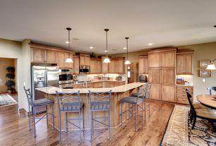 Craftsman Kitchen with Breakfast nook, Sea Gull Lighting Windgate 1 Light Mini-Pendant, Breakfast bar, Flush, Limestone Tile