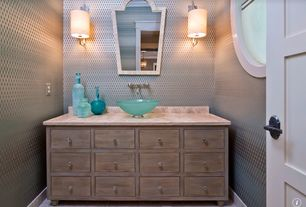 Eclectic Powder Room with Limestone, specialty window, Inset cabinets, partial backsplash, Kraus frosted glass vessel sink
