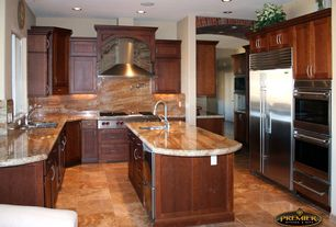 Traditional Kitchen with Onyx counters, Wall Hood, Flush, Built In Refrigerator, can lights, Flat panel cabinets, Casement