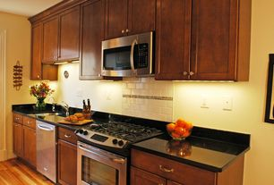 Traditional Kitchen with Standard height, Undermount sink, European Cabinets, Soapstone counters, dishwasher, Hardwood floors