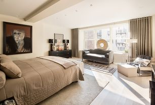 Contemporary Master Bedroom with Window seat, Laminate floors, Exposed beam