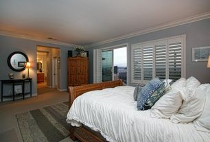 Traditional Guest Bedroom with sliding glass door, Standard height, Crown molding, Carpet