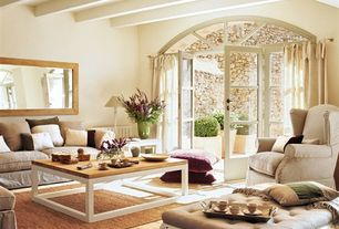 Traditional Living Room with limestone tile floors, Exposed beam, Transom window, French doors
