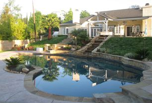 Rustic Swimming Pool with Raised beds, Bay window, French doors, exterior stone floors, Outdoor kitchen, Fence, Pathway