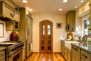 Country Living Room with Casement, Built-in bookshelf, Standard height, French doors, can lights, Hardwood floors