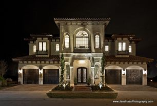 Mediterranean Exterior of Home with Raleigh Wrought Iron Co. Custom Wrought Iron Balcony