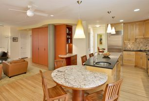 Contemporary Great Room with Hardwood floors, double-hung window, Standard height, Pendant light, Built-in bookshelf