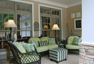 Traditional Porch with Wicker armchair, Upholstered ottoman, Painted wood ceiling, Neutral area rug, Outdoor seating