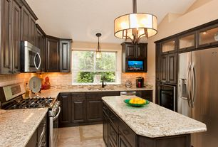 Traditional Kitchen with Kitchen island, flush light, Pendant light, Limestone Tile, Raised panel, Glass panel, dishwasher