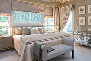 Traditional Master Bedroom with Accent pillows, Carpet, interior wallpaper, Chandelier, Crown molding, Diamond pattern carpet