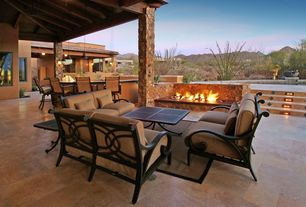 Contemporary Patio with Fire pit, Outdoor kitchen, picture window, Fence, Pathway, exterior stone floors