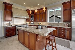 Traditional Kitchen with Flat panel cabinets, Breakfast bar, Pendant light, Kitchen island, Flush, Stone Tile, Custom hood