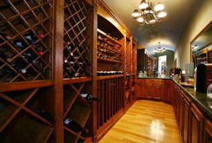 Traditional Bar with Chandelier, Built-in bookshelf, Hardwood floors, Premier Wine Cellar Modular Wine Cellar Kits