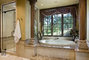 Traditional Master Bathroom with Columns, can lights, drop in bathtub, Standard height, Wall Tiles, Casement, Paint, Shower