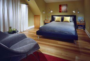 Contemporary Guest Bedroom with specialty door, Hardwood floors, High ceiling, Paint, bedroom reading light
