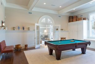 Traditional Game Room with Arched window, Box ceiling, French doors, Hardwood floors, Window seat, Wall sconce, Crown molding