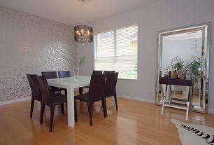 Art Deco Dining Room with Chandelier, Blomus Lounge Shaker, Laminate floors, interior wallpaper