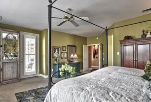 Traditional Master Bedroom with Standard height, French doors, Carpet, Built-in bookshelf, Ceiling fan