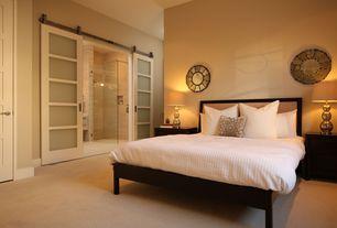 Contemporary Master Bedroom with Paint, specialty door, Carpet, Barn style sliding doors, sliding glass door, Standard height