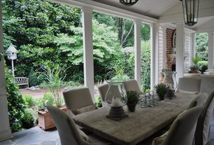 Traditional Porch with Fence, Covered patio, Slip side chair with linen slipcover, Pathway, Screened porch