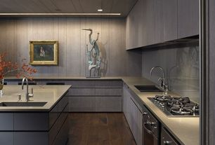 Contemporary Kitchen with Kitchen island, Undermount sink, European Cabinets, Corian-solid surface countertop in dove, Flush