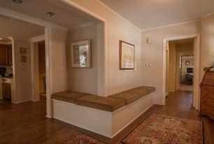 Cottage Hallway with interior wallpaper, Crown molding, Hardwood floors
