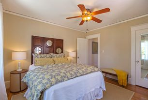 Traditional Master Bedroom with specialty door, Crown molding, Hardwood floors, French doors, Ceiling fan