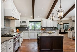 Traditional Kitchen with Flat panel cabinets, Pendant light, Subway Tile, Wolfe - 6 burner + griddle, double oven, U-shaped