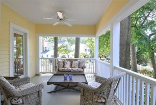 Country Porch with Deck Railing, Wrap around porch, picture window, French doors, exterior concrete tile floors, Casement