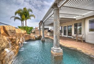 Eclectic Swimming Pool with exterior stone floors, Waterfall feature, Pool with hot tub, Trellis, Stamped concrete patio